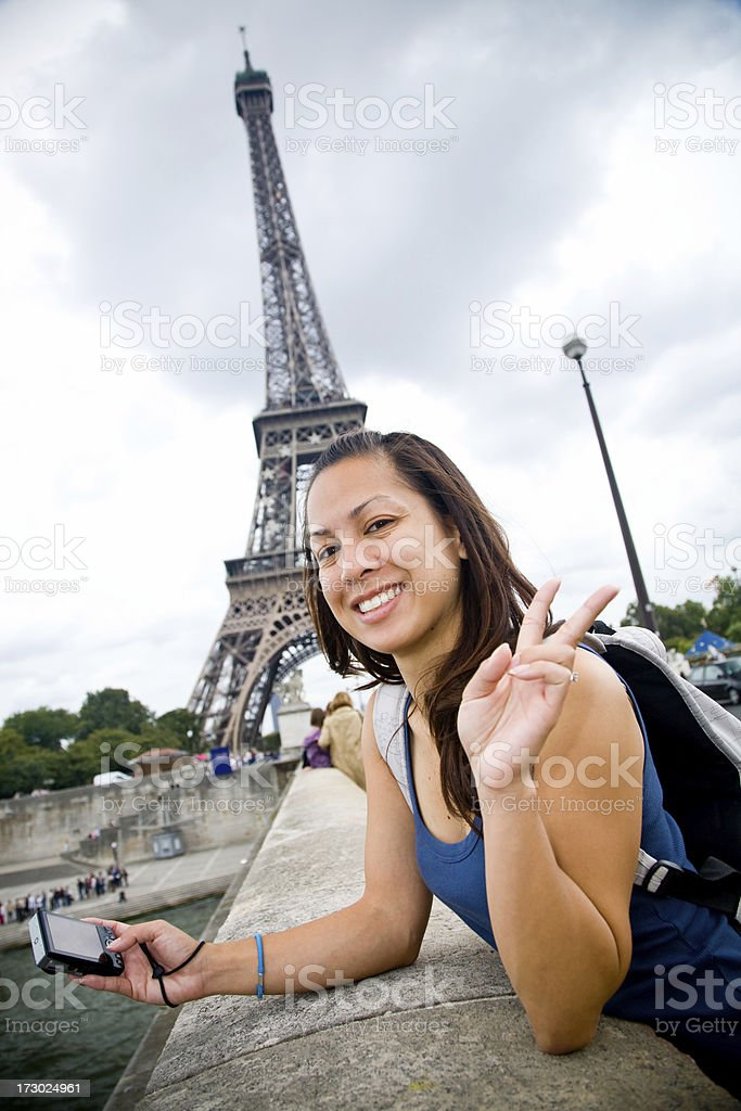 tourist girl in paris by the eiffel tower royalty-free stock photo
