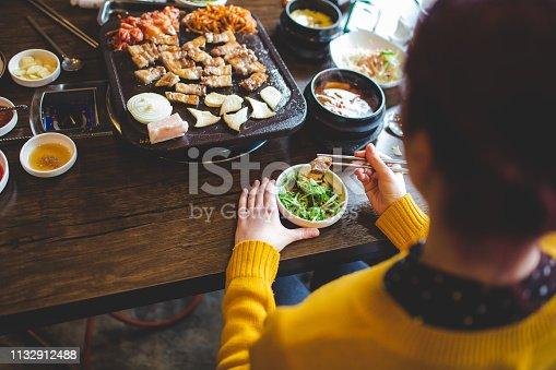 istock Tourist Girl Tasting Korean Food 1132912488