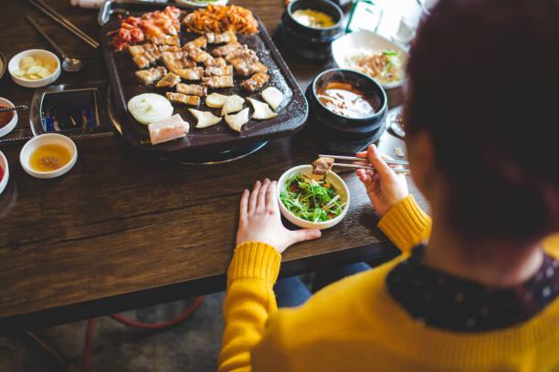 Tourist Girl Tasting Korean Food stock photo