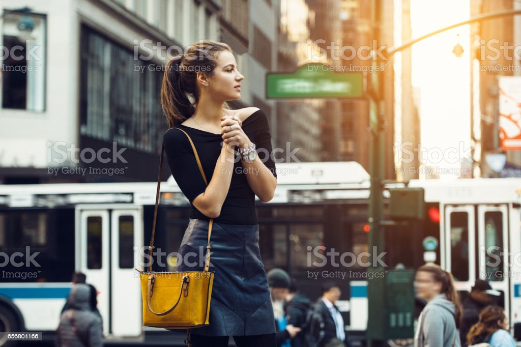 tourist girl traveling and enjoing busy city life stock photo