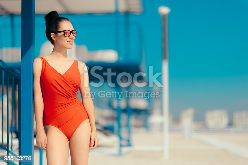 Stylish woman enjoying vacation time at the beach