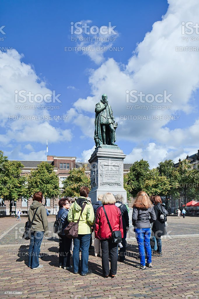 Tourist group around statue of Frederick William I, Netherlands stock photo