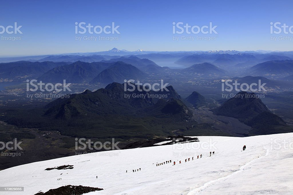 Tourist Group Hiking the Villarrica Volcano, Pucon, Chile royalty-free stock photo