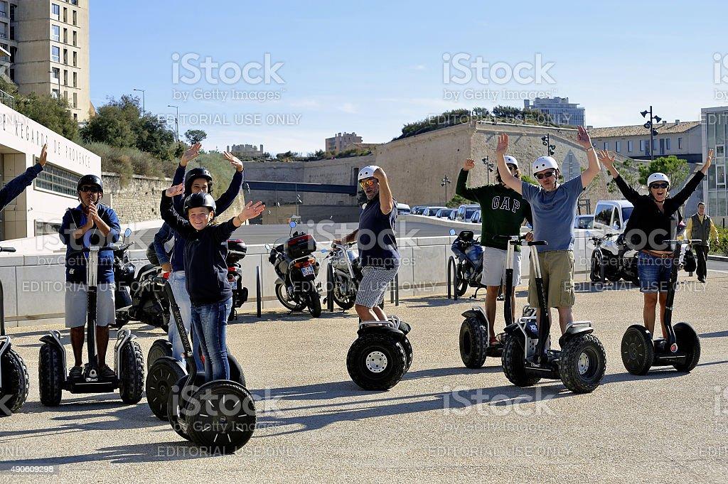Tourist group moving Segway stock photo
