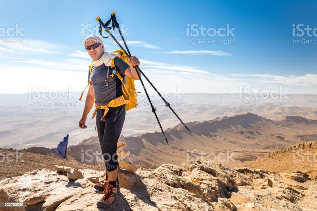Tourist man guy guide mountaineer standing stone desert mountain...
