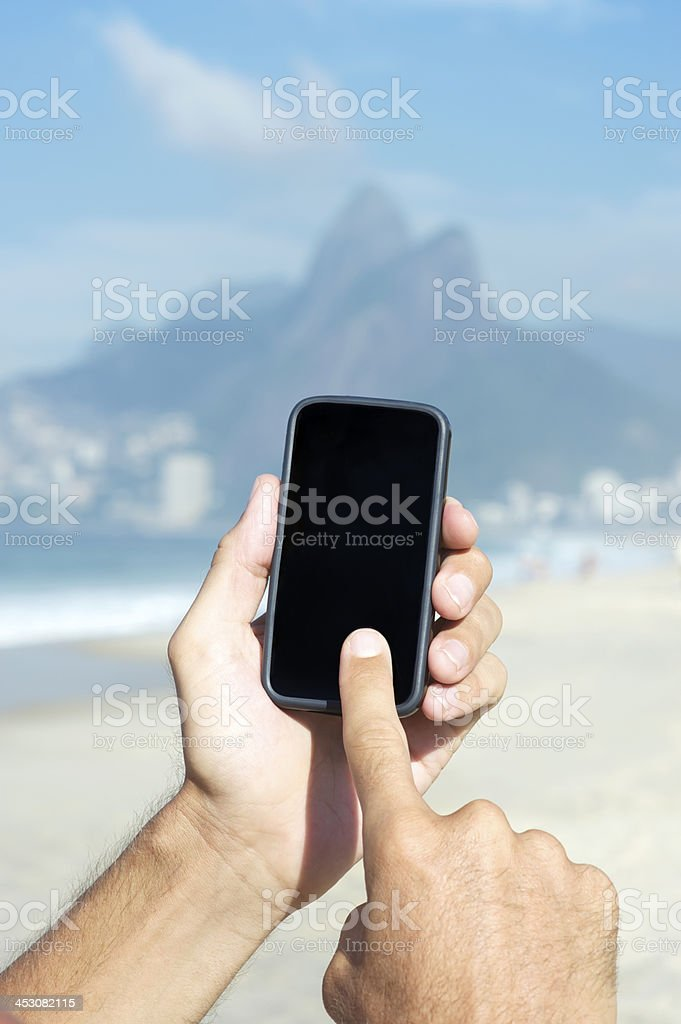 Tourist Hands Using Touchscreen Smartphone in Rio de Janeiro Brazil royalty-free stock photo