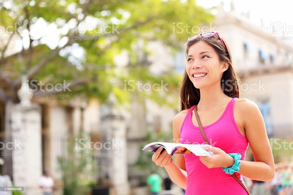 Tourist happy reading guide book stock photo