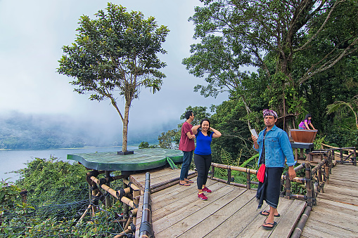 istock Tourist having fun taking photo at a man made platform with Buyan lake as the background 1249480765