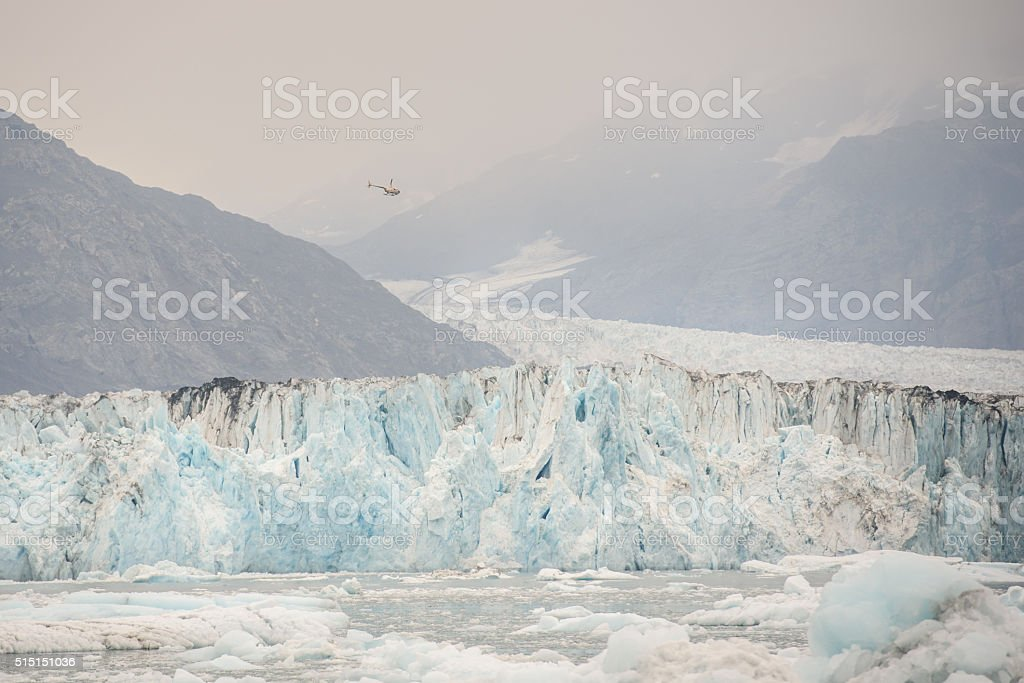 Tourist Helicopter Flying Over Columbia Glacier in Alaska stock photo
