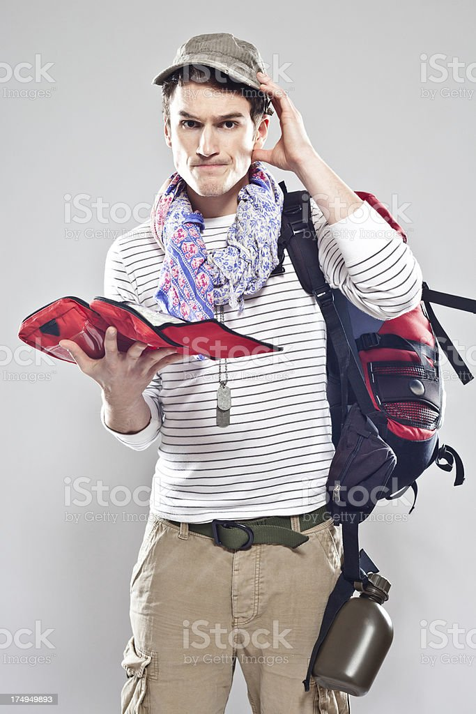 Tourist holding firts aid kit royalty-free stock photo