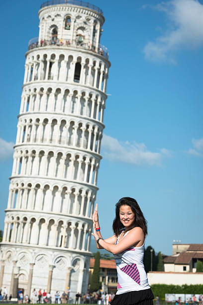 tourist holding the leaning tower on Pisa stock photo