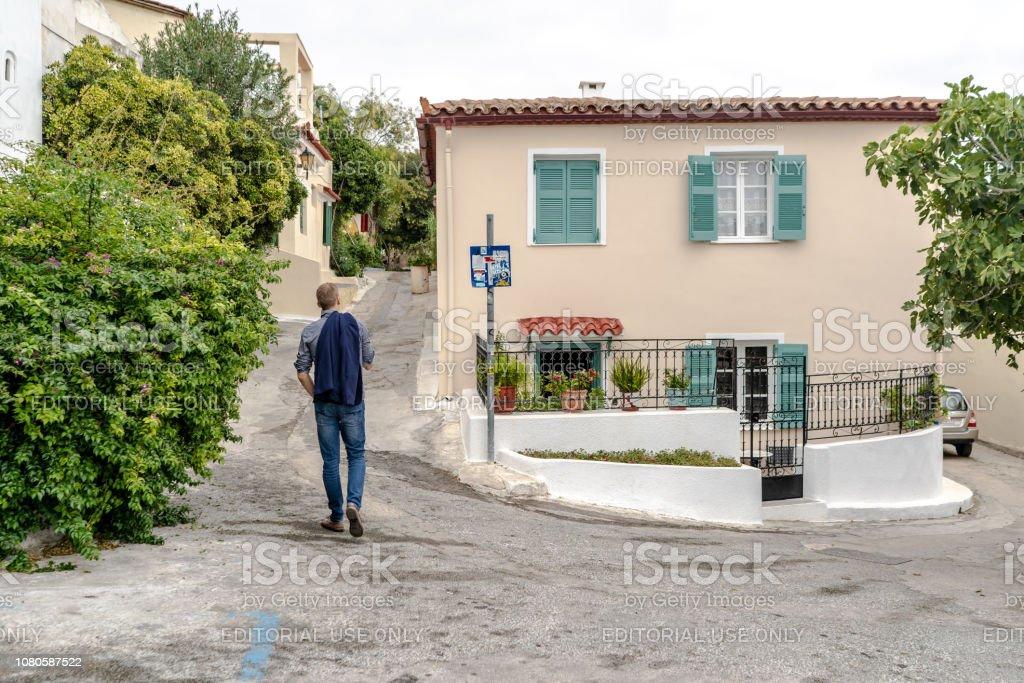 Tourist in Anafiotika in Athens, Greece stock photo
