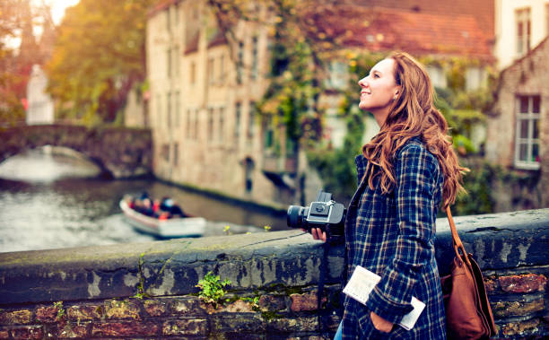 Tourist in Bruges Young woman with a camera enjoying travel to Bruges, Belgium belgium stock pictures, royalty-free photos & images