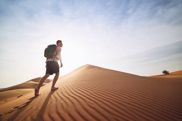 Tourist in desert stock photo