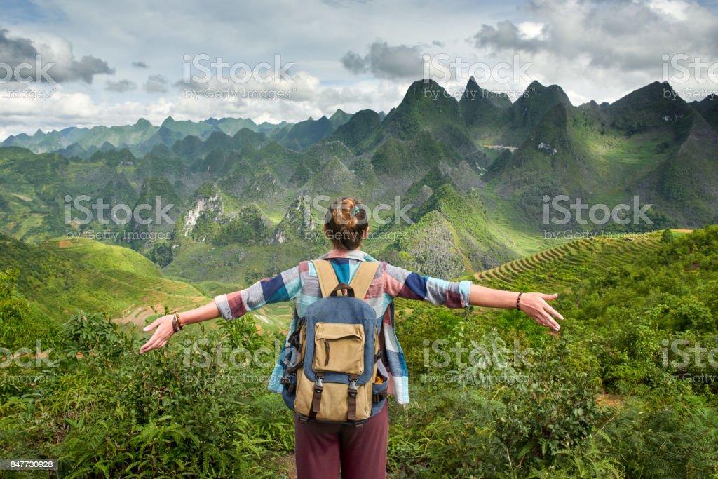 tourist in mountains enjoying on view of mountains. stock photo