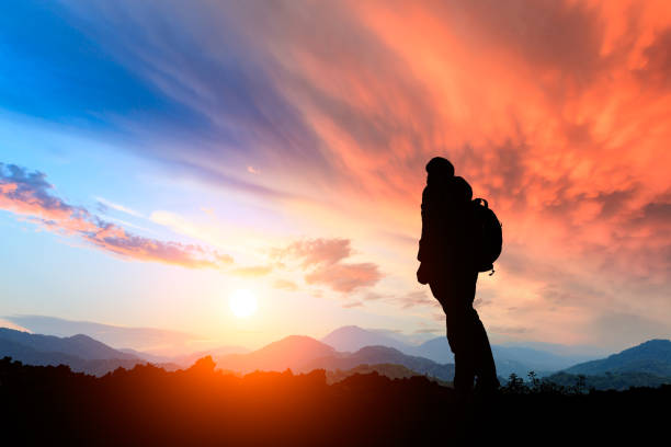 tourist in mountain,sport and active life - mountain sunset stock photos and pictures