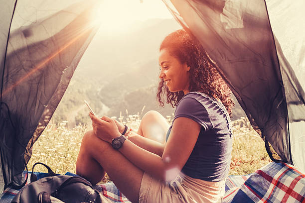 Tourist in the mountain text messaging stock photo