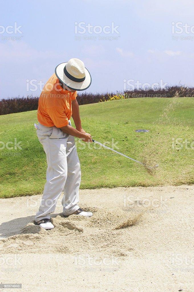 Tourist in den sand trap Lizenzfreies stock-foto