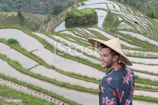 607590542istockphoto Tourist in traditional rice plantation 1158419500