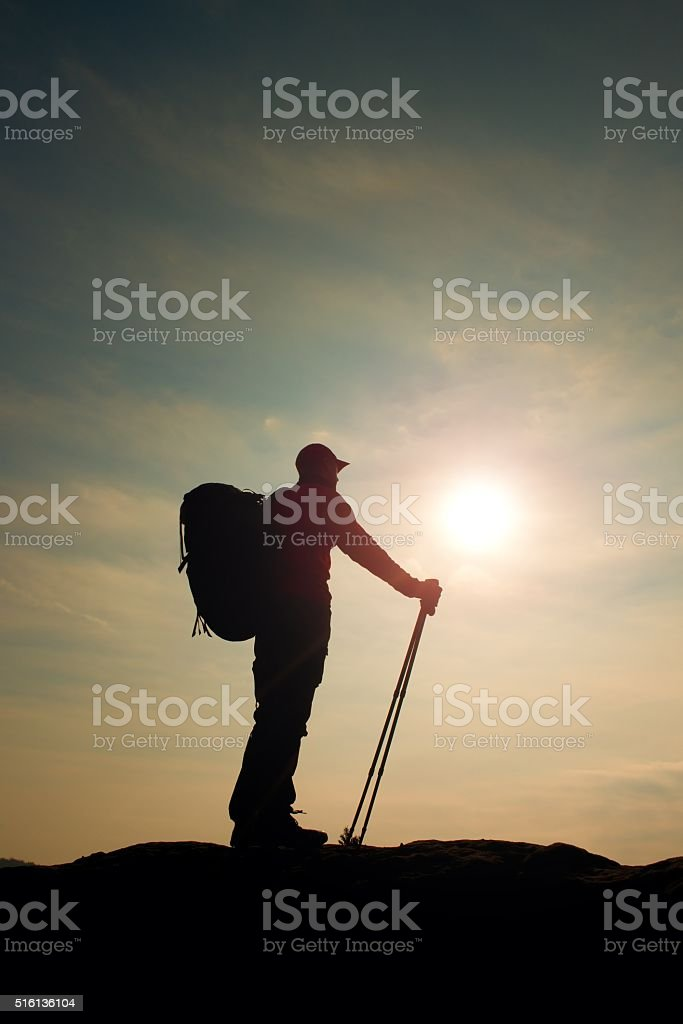 Tourist in windcheater on rocky view point. stock photo