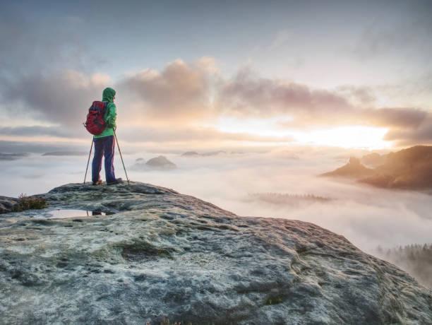 Tourist in windcheater with backpack enjoy amazing daybreak stock photo