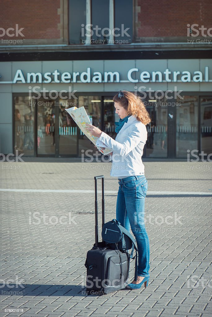 Tourist inl Amsterdam watching the map stock photo