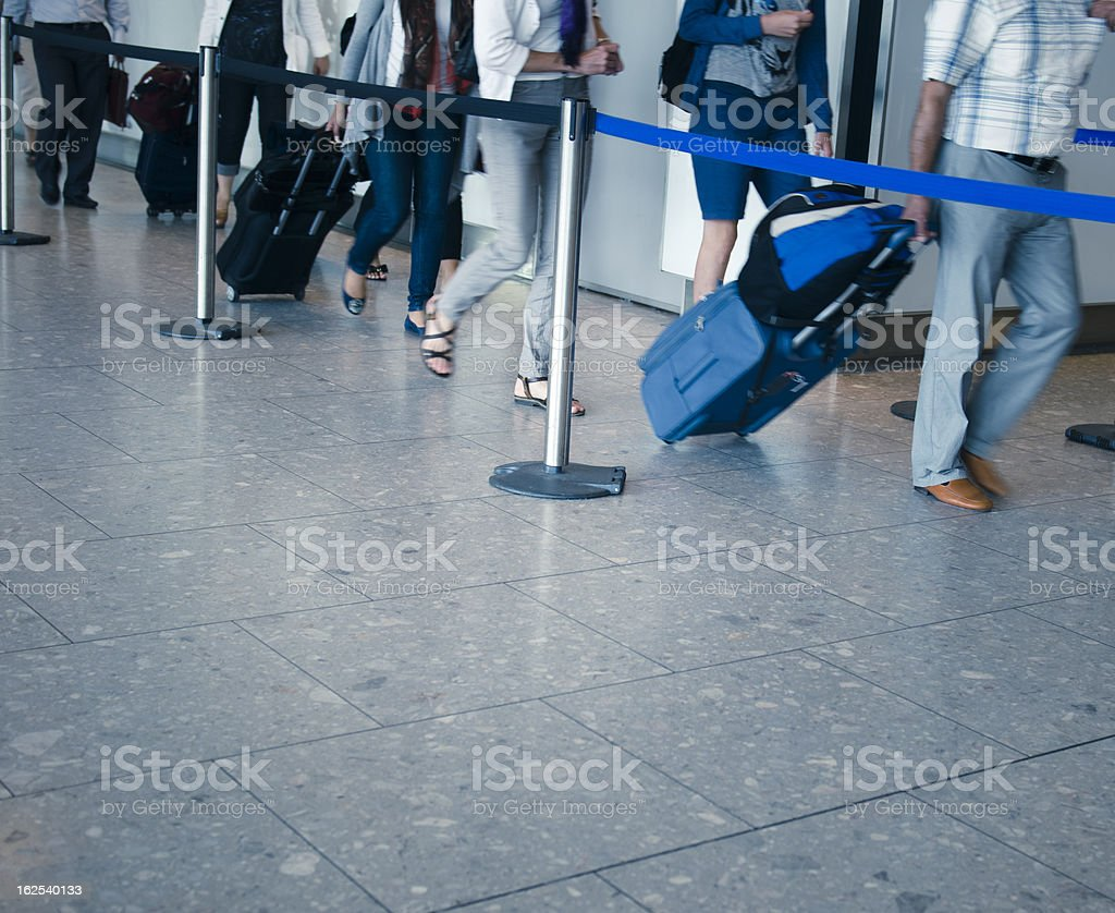 Tourist inside a contemporary airport in queue royalty-free stock photo