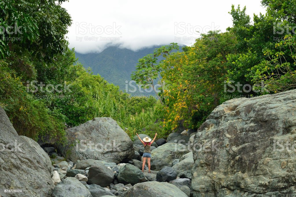 Tourist is resting by the small waterfall stock photo