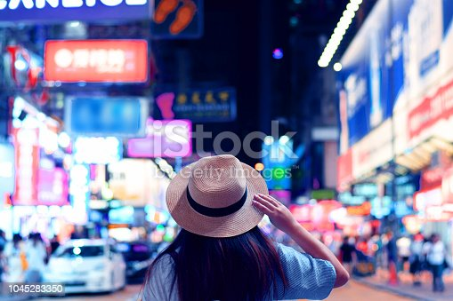Tourist is visiting at Mong Kok night market in Hong Kong.