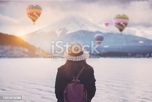 istock Tourist is watching the beautiful view at Lake Kawaguchiko with Mt. Fuji view in Japan during winter. 1002925088