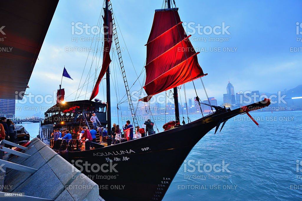 Tourist Junk ship in Victoria Harbour, Hong Kong stock photo