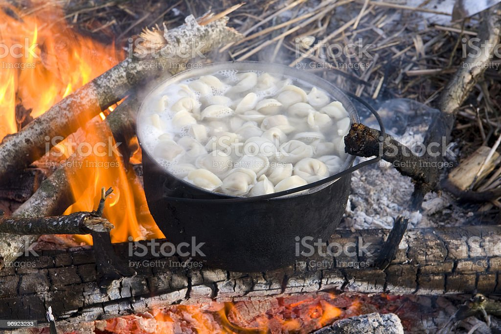 Tourist kettle on hot fire royalty-free stock photo
