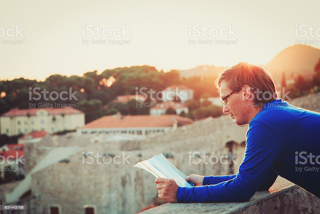 tourist looking at map in the city of Dubrovnik stock photo