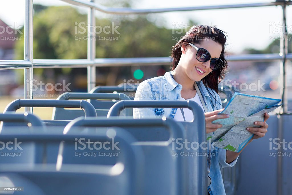 tourist looking at map on open top bus stock photo