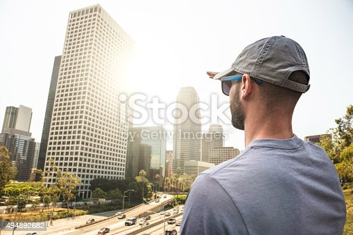 istock Tourist looking at the los angeles skyline 494892682