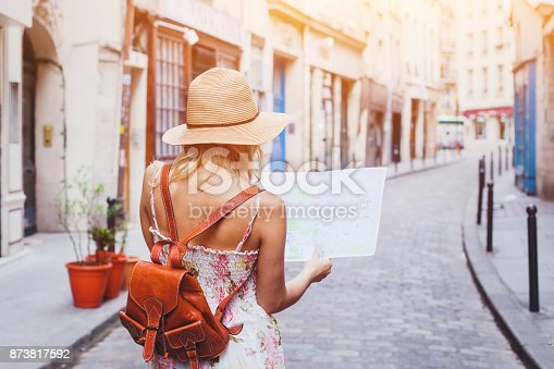 istock tourist looking at the map, travel to Europe 873817592