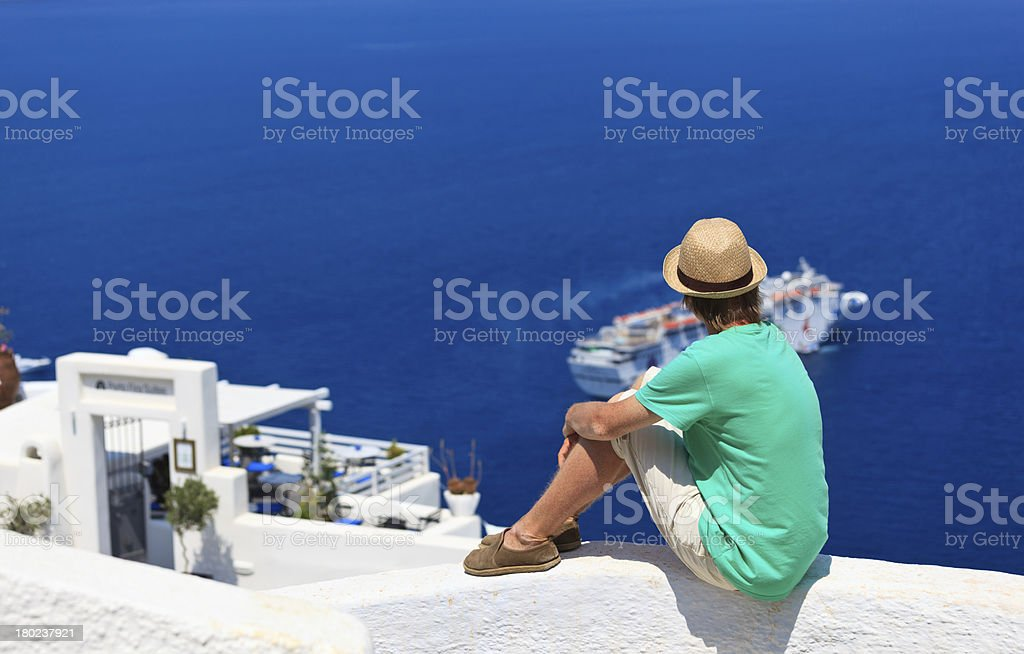 tourist looking at the sea in Santorini, royalty-free stock photo