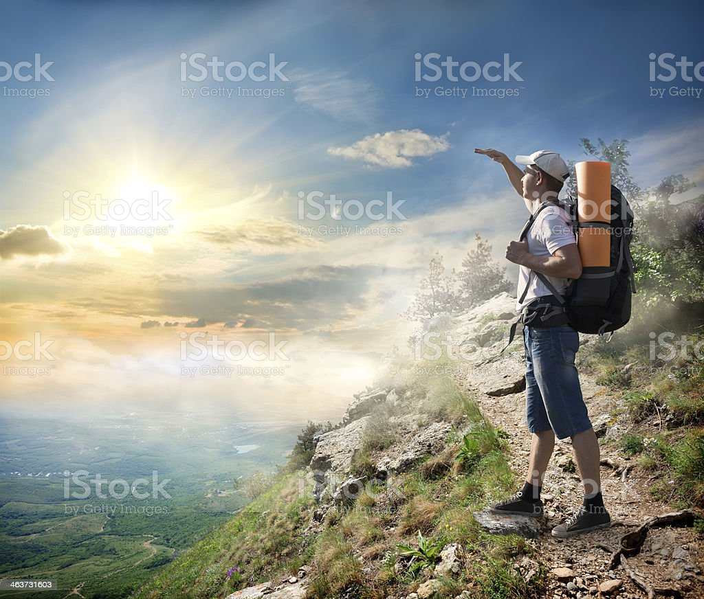 Tourist looking at the sun royalty-free stock photo