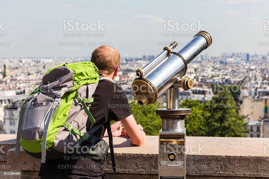 Tourist looking over Paris landscape from Montmartre observation deck. Paris, France royalty-free stock photo