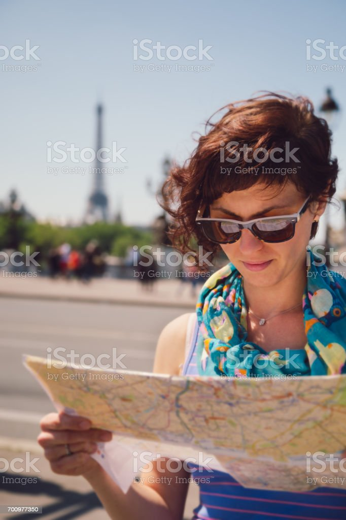 Tourist looks at map of Paris stock photo