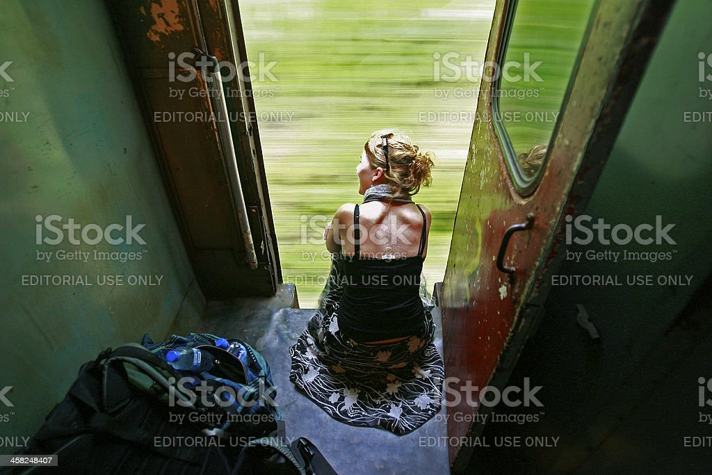 Tourist looks out of train stock photo