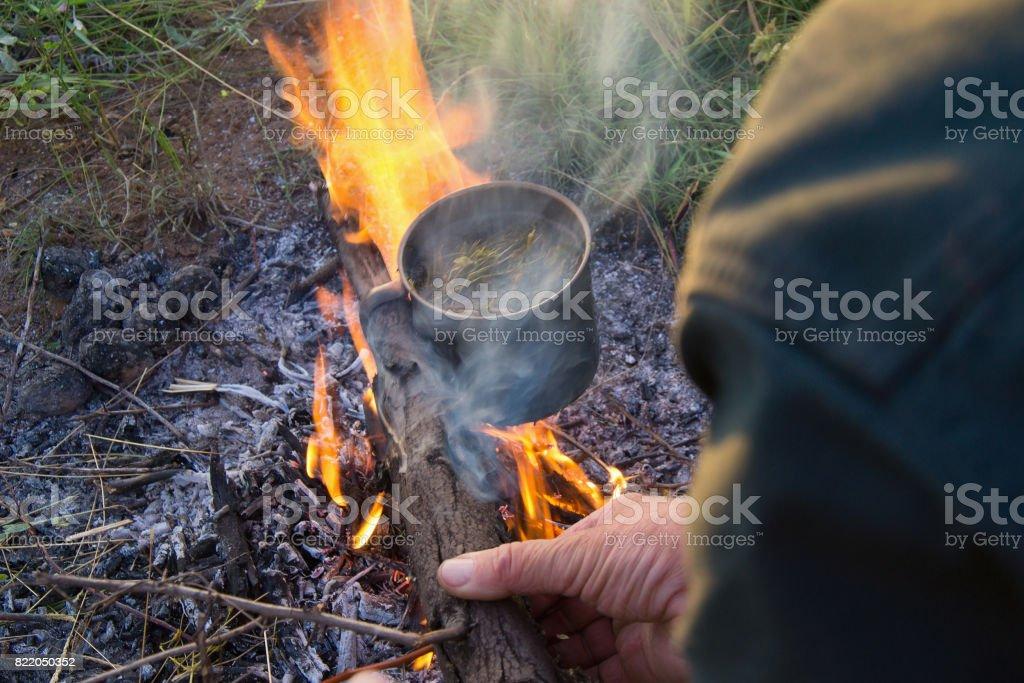 Tourist make tea on fire stock photo