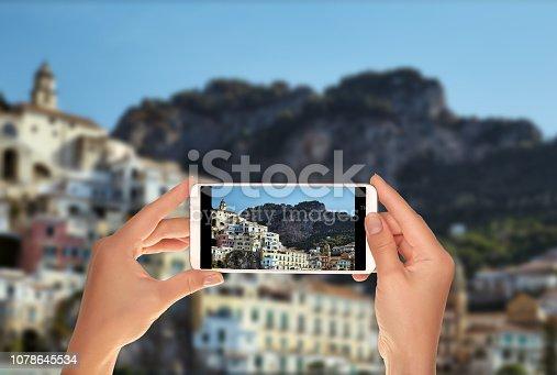 599114758 istock photo Tourist makes a photo of Amalfi town 1078645534