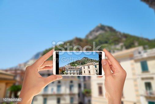 599114758 istock photo Tourist makes a photo of the city of Amalfi 1078645562