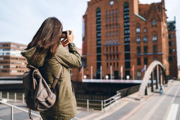 Tourist making photos in hafen city picture id1131878620?b=1&k=6&m=1131878620&s=612x612&w=0&h=sbppzs 7nop6kzldx7bzuris ehhfgzmrsam1lvm62u=
