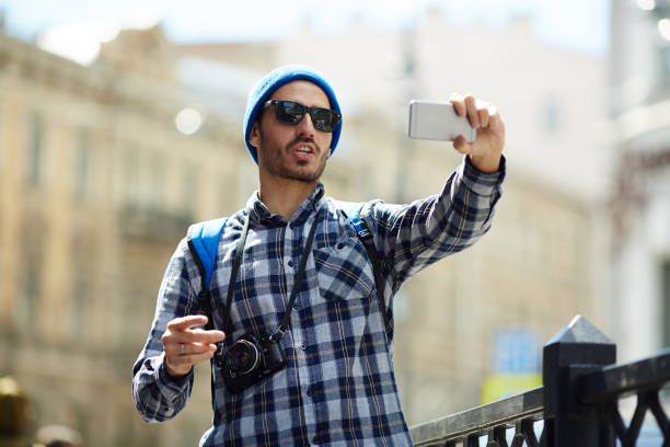 tourist making selfie - vlogger stock photos and pictures
