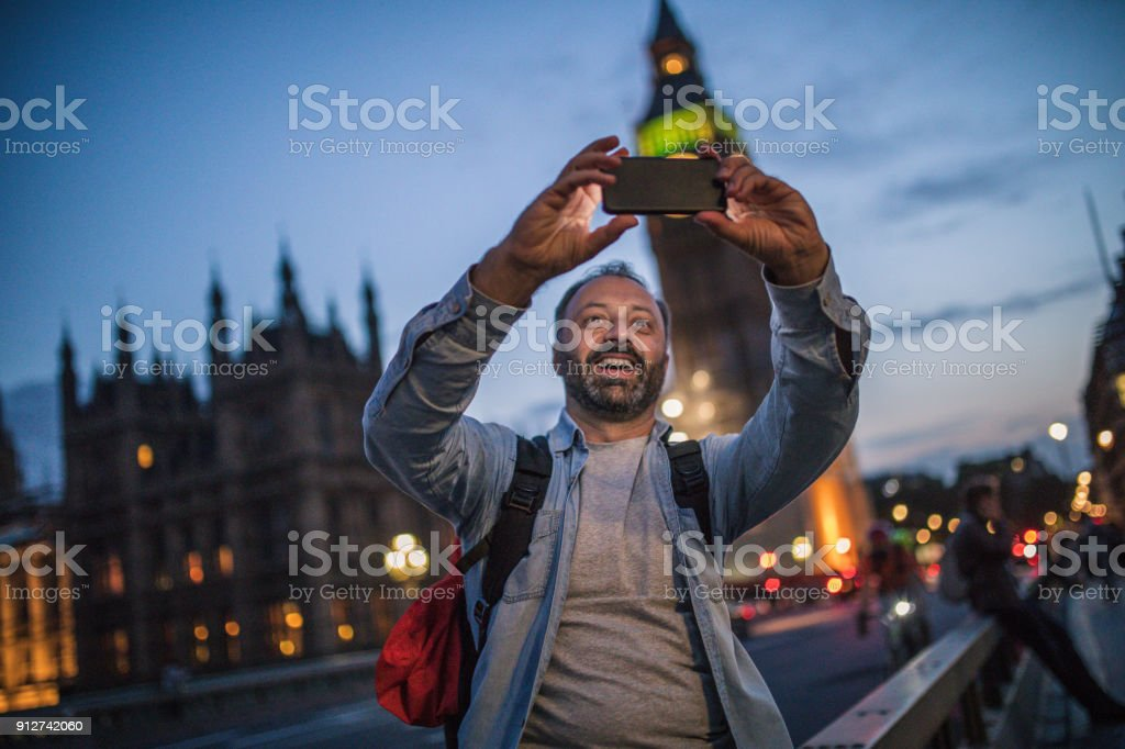 Tourist man in London making selfie stock photo