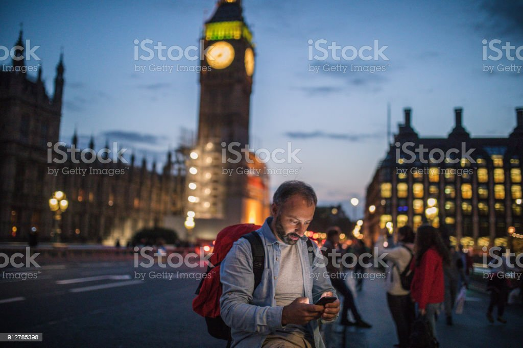 Tourist man in London texting stock photo