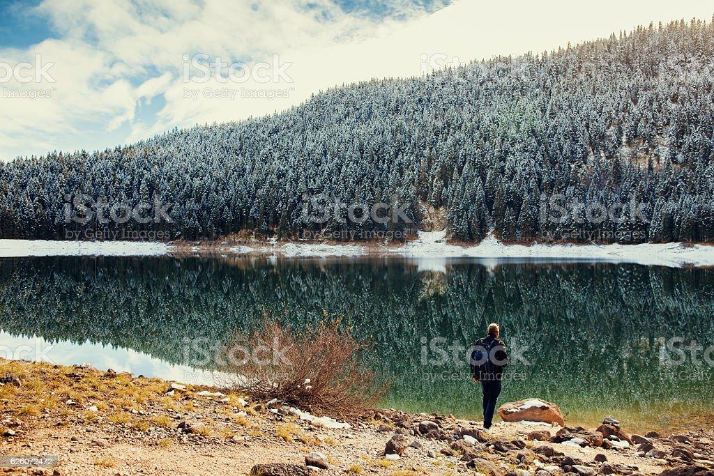 tourist man travel to snowy mountains background stock photo