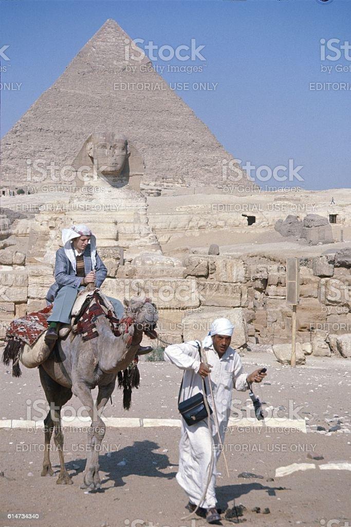Tourist on Camel, Pyramids, Egypt stock photo
